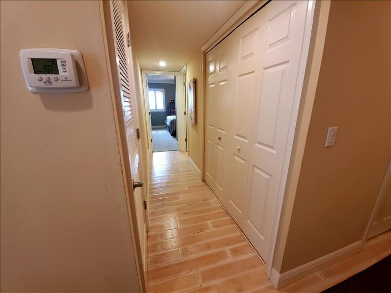 hallway to guest room and guest bath.. also ac in closet