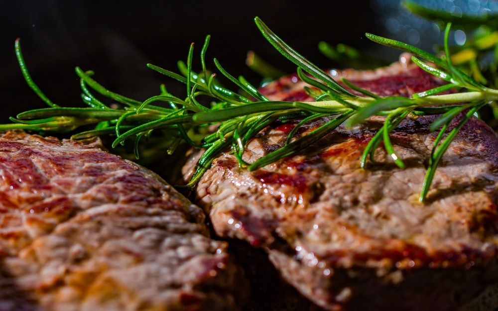 Steaks with rosemary garnish