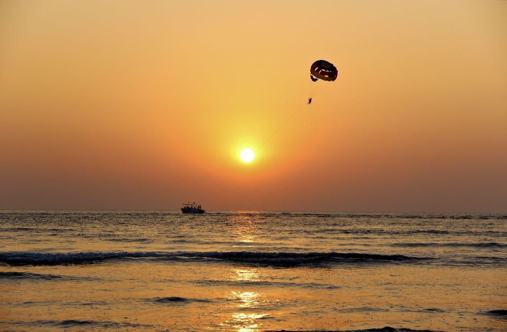 parasailing at sunset