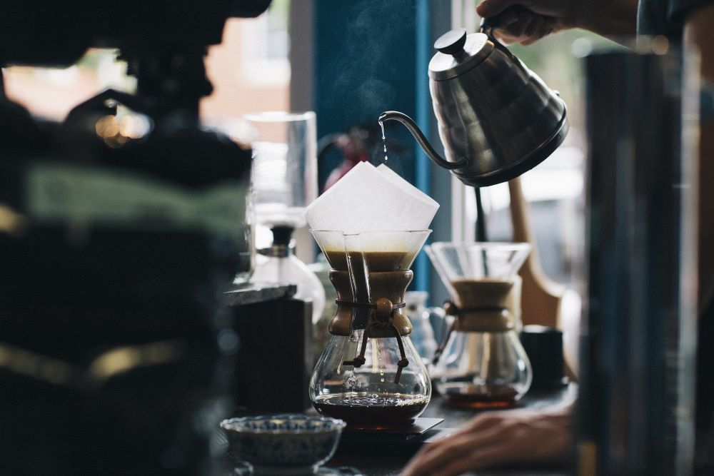 someone making pour-over coffee