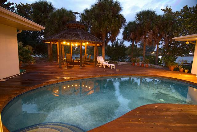 backyard with pool at night