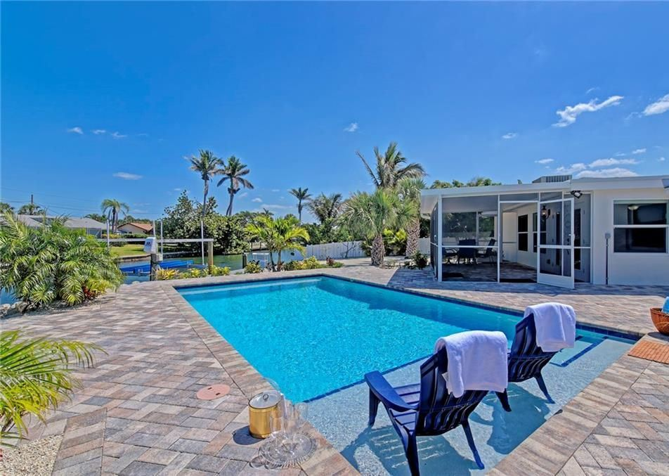 backyard of Holmes Beach rental with a  pool