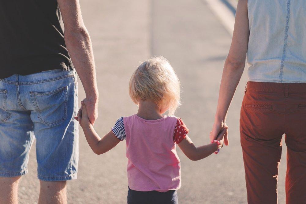 couple walking with kid