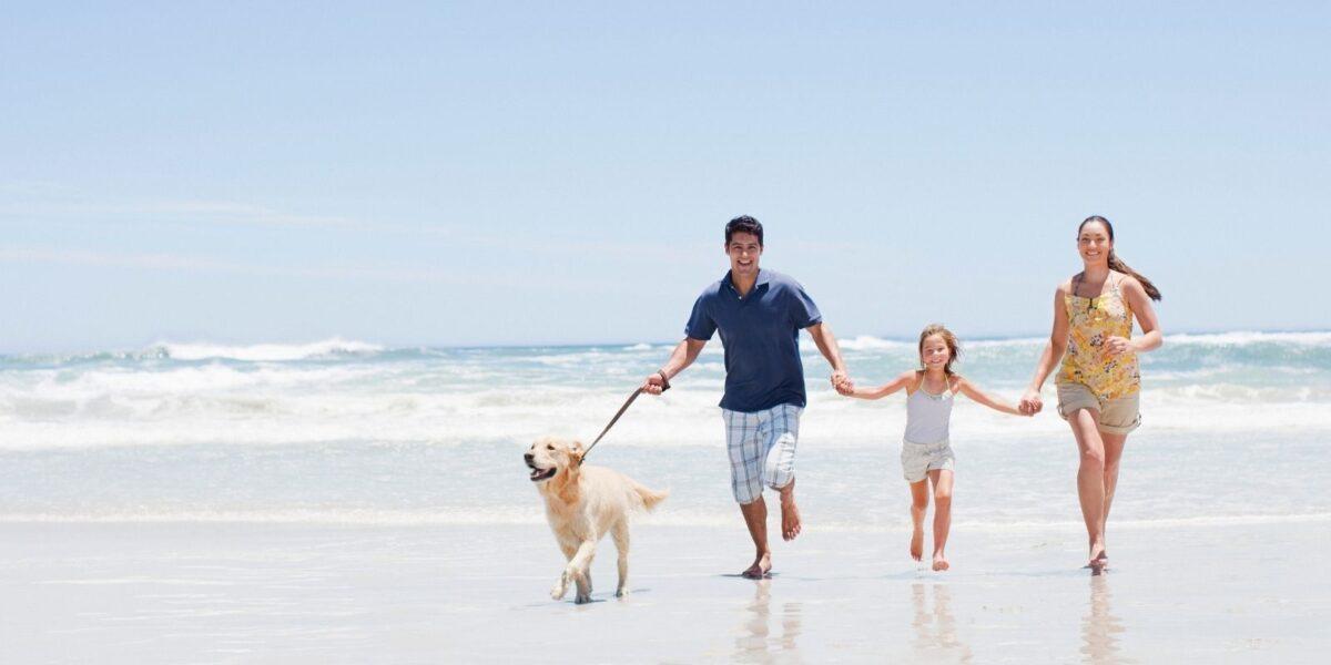 family running down the beach