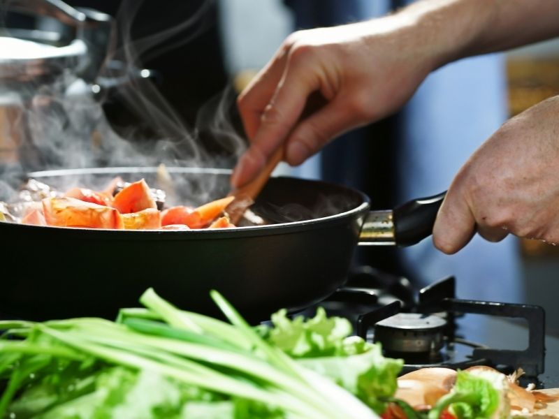 cooking in a pan on stove