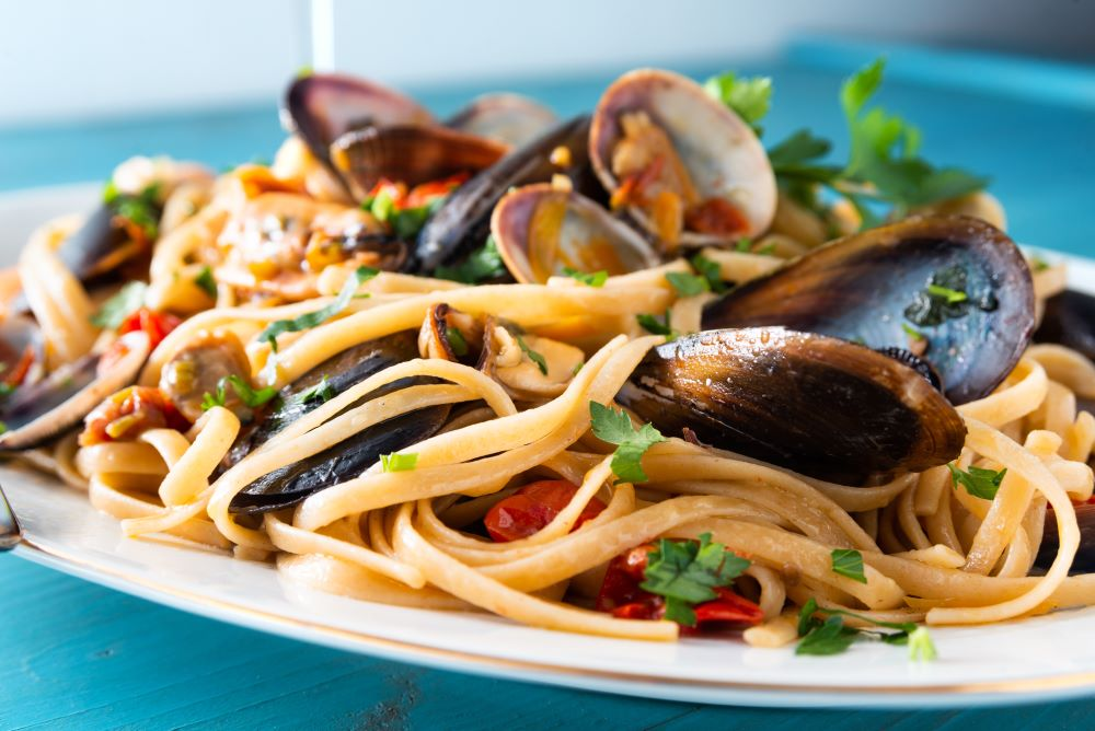 Plated pasta dish with mussels